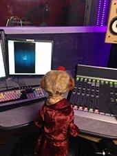 Aleksandr the Meerkat filming a TV ad in the studio